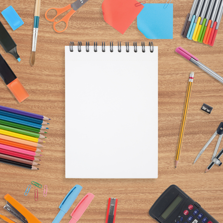 Open Blank  Sketch book and school tools on wood background Stock Photo