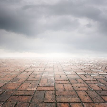 rainclouds: Brick floor and rainclouds for background Stock Photo
