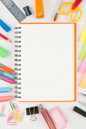 Open blank Notebook and school or office tools on white background Stock Photo