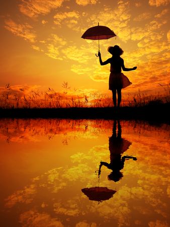 reflection: Umbrella woman and sunset silhouette with Water reflection.
