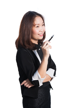 Asia business woman writing and smiling happy on white background. Foto de archivo