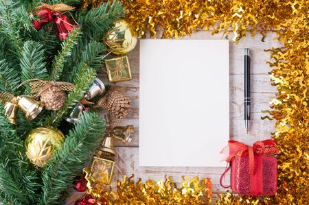 christmas decorations with white background: Christmas decorations and notebook on vintage white wood background. Stock Photo