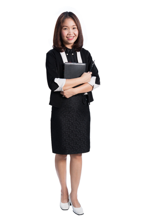 Happy business woman holding notebook and smiling  on white background Foto de archivo