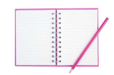 Lápiz de color púrpura en la cara cuaderno púrpura para el fondo y la parte de recorte Foto de archivo - 58371154