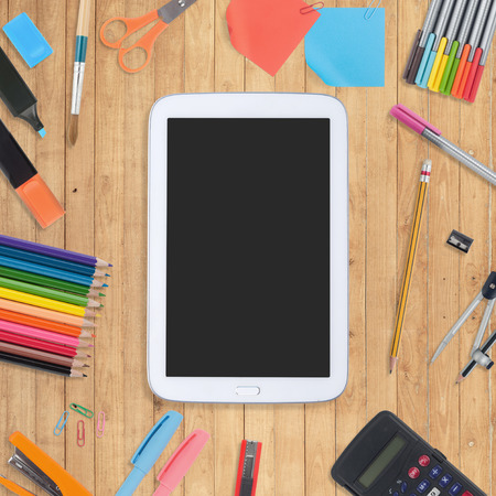Blank Tablet, phone, book and school tools on wood background Stock Photo