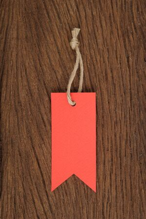 Red tag on Wood table for text