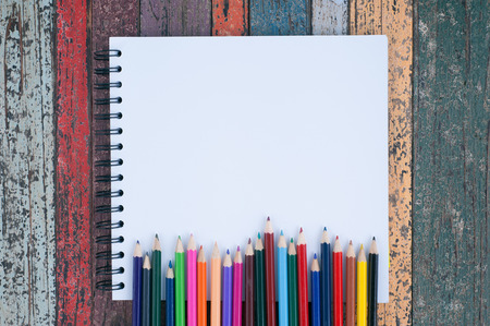 Color pencil on sketch book and vintage wood table for background and text