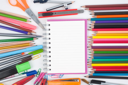 Notebook and school or office tools on white background