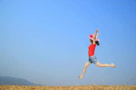 Happy Woman Jumping with blue sky outdoor.