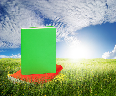 Color Books in grass fields and blue sky
