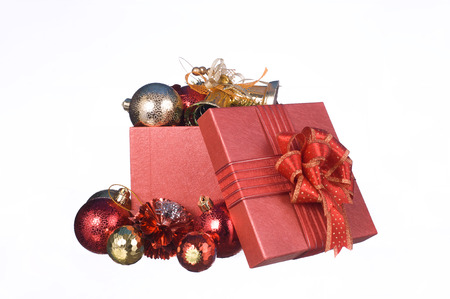 Christmas gift box with decorations and color ball isolated on white background