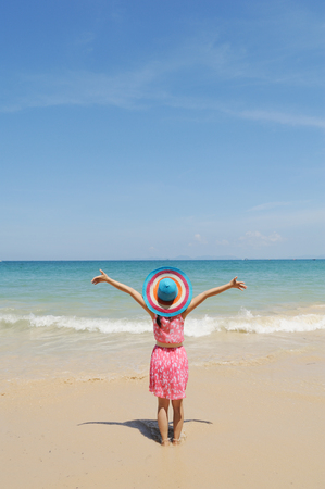 Woman in Sea and Blue sky on happy day at Thailand