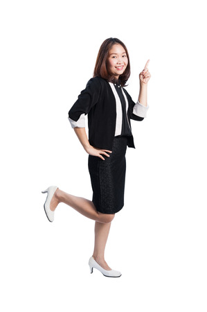 Happy of asian Businesswoman pointing on white background Foto de archivo