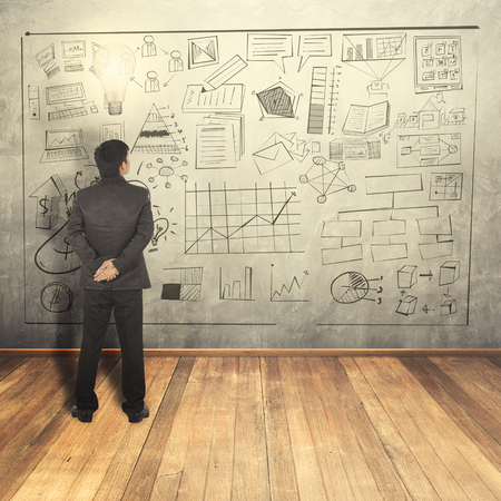 Businessman thinking idea on Wood floor and concrete