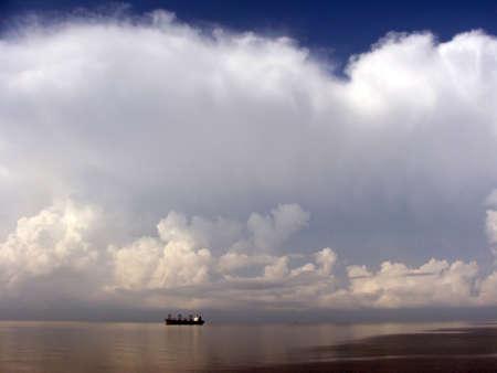industry moody: Image of Sea ship clouds sky blue Stock Photo