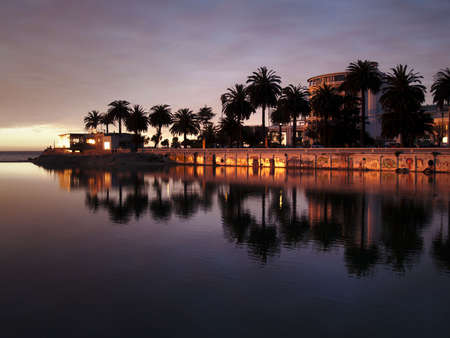 City of Vina del Mar (Chile) reflecting on the river Marga Marga at dusk photo