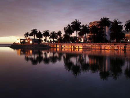 City of Vina del Mar (Chile) reflecting on the river Marga Marga at dusk