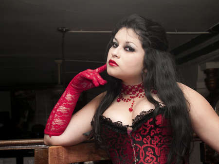 red corset: Beautiful cabaret woman in red corset portraited  Stock Photo
