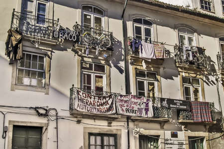 egalitarian: Coimbra, December 2012  Balconies on downtown building  Feminist claims and demands on called Baco and Marias do Loureiro Republics