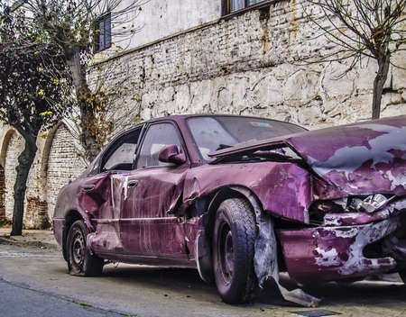 A crashed car left on the street photo