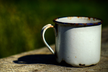 unbreakable: Old enameled mug Stock Photo