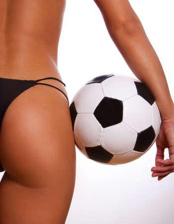 pieds sexy: Jeune fille sexy avec des ballons de football