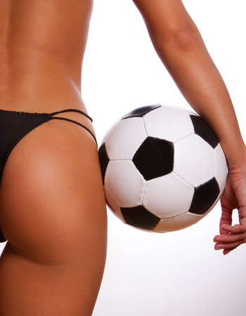 Young sexy girl with soccer ball Reklamní fotografie