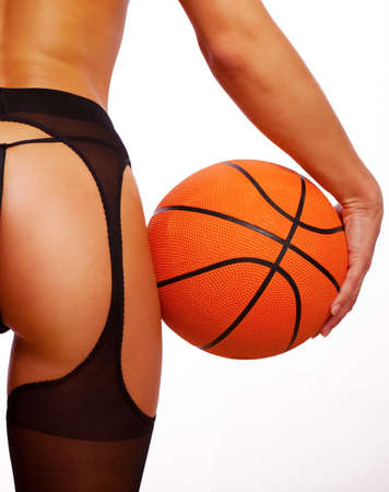 woman buttocks: Young sexy girl with basket ball