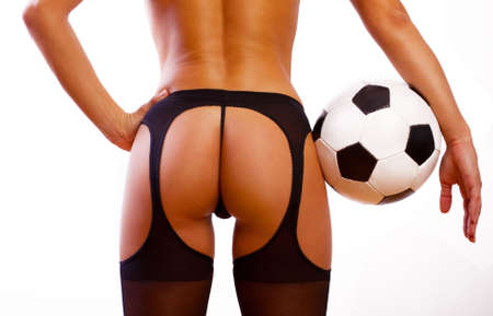 female buttocks: Young sexy girl with soccer ball Stock Photo