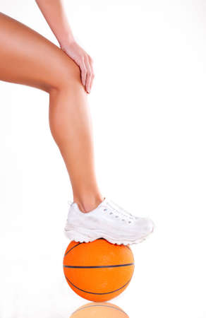 sneakers: Women bare legs and sneakers with basket ball Stock Photo