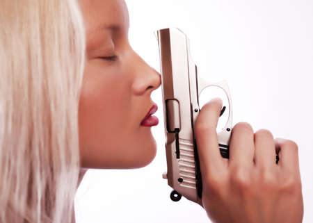 Portrait of young sexy woman holding her gun Stock Photo