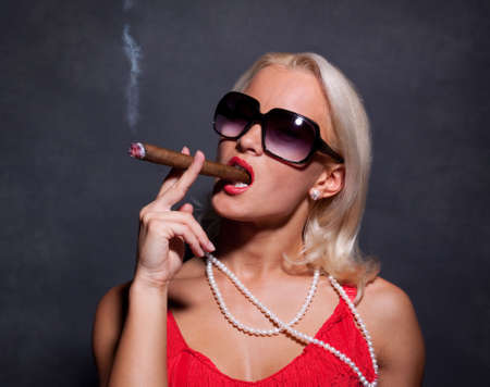 jewel hands: Portrait of elegant smoking woman. Fashion photo