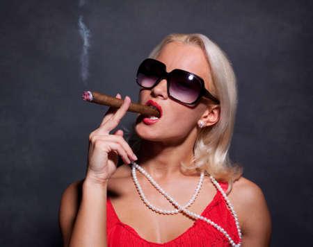 jewel hands: Portrait of elegant smoking woman. Fashion photo