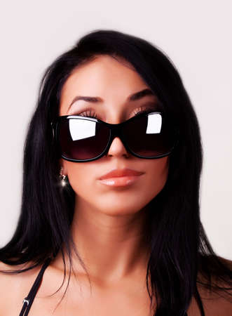 Portrait of young sexy woman with sunglasses Stock Photo - 5429277