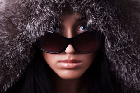 Portrait of young sexy brunette with sunglasses in darkness Stock Photo - 5429273