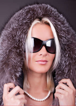 Portrait of young sexy woman with sunglasses in  coat photo