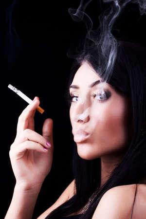 cigar smoking woman: Portrait of elegant smoking brunette. Fashion photo