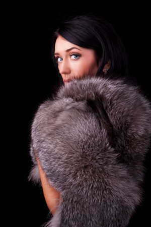 Portrait of a attractive brunette wearing luxurious coat photo