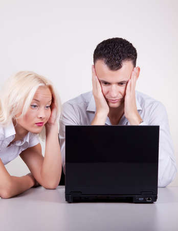 Portrait of two people working with stress in office photo