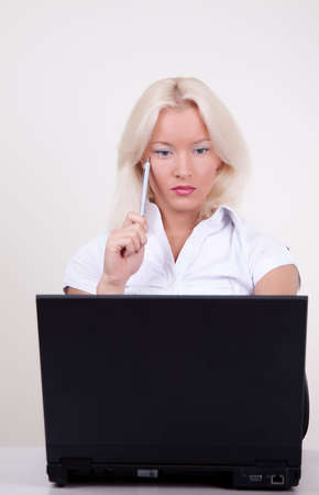 Portrait of young businesswoman using laptop Stock Photo - 5597466