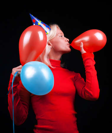 Portrait of attractive happy woman with balloons celebrating  photo