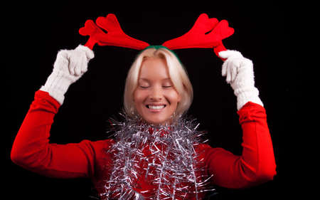 Portrait of a cute young woman with horns on her head. Christmas time Stock Photo - 5597507