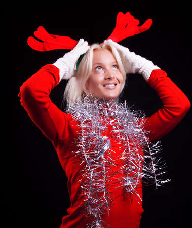 Portrait of a cute pensive woman with horns on her head. Christmas time photo