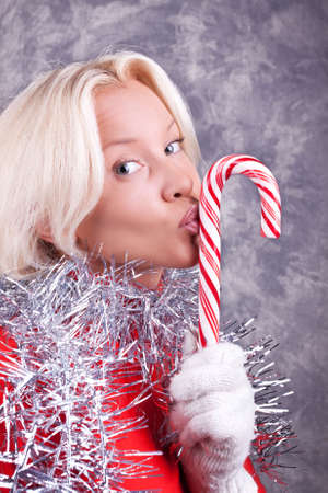 Portrait of young sexy blonde kissing her Christmas candy Stock Photo - 5597624