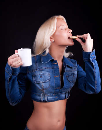 Portrait of attractive young woman eating cookie Stock Photo - 5597631