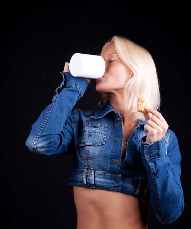 Portrait of attractive young woman drinking a coffee photo
