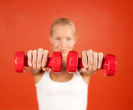 Close up of weights in womans hands photo