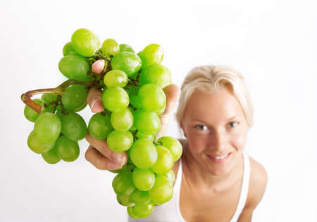 Picture of green grapes in hands of blond girl photo