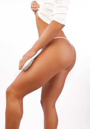 thong bikini: Picture of body part  of beautiful woman isolated on white. Skincare procedure in spa