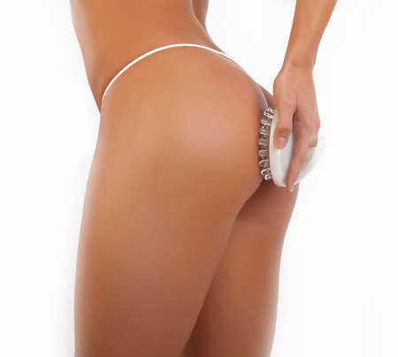 thongs: Picture of ass of sexy girl isolated on white. Massage procedure